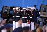 US Marines salute at Andrews Air Force Base in Maryland on September 14 during the transfer of remains ceremony for the four Americans killed in Benghazi, Libya, in an attack this week. Libya announced Sunday the arrest of 50 suspects, blaming the Benghazi attack on foreign extremists and claiming it was pre-planned