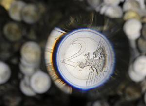 A two Euro coin is checked in the Austrian Mint headquarters in Vienna