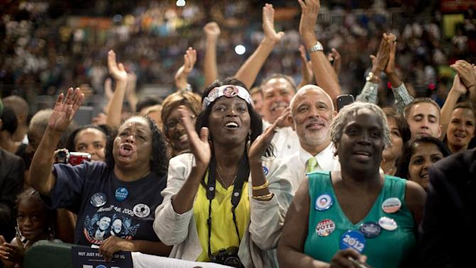 Charlenia Rutland-Persones, center with headband, and others cheer as President Barack Obama speaks at a campaign event at the University of Miami, Thursday, Oct. 11, 2012, in Coral Gables, Fla. (AP Photo/Carolyn Kaster)