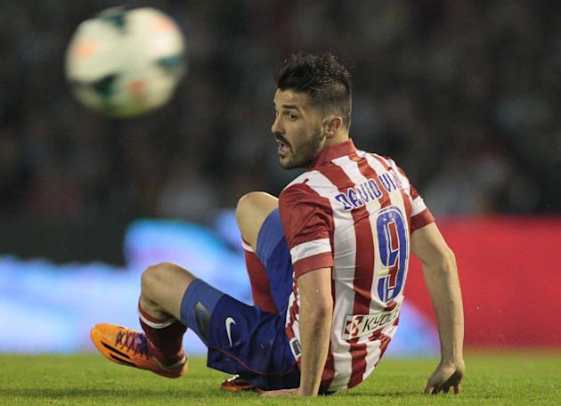 Atletico's David Villa gestures during the Spanish La Liga soccer against Real Club Celta at the Balaidos stadium in Vigo, Spain, Saturday March 8, 2014