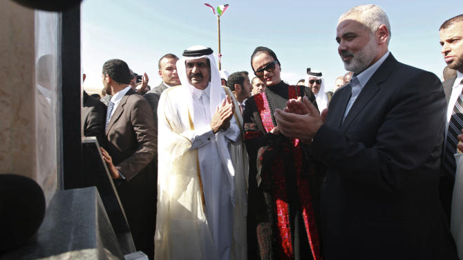 Emir of Qatar Sheikh Hamad bin Khalifa al-Thani, left, his wife Qatar's First Lady Sheika Mozah bint Nasser al-Missned, center, and Gaza's Hamas prime minister Ismail Haniyeh, right, attend a the corner-stone laying ceremony for Hamad, a new residential neighborhood in Khan Younis, southern Gaza Strip Tuesday, Oct. 23, 2012. The emir of Qatar received a hero's welcome in Gaza on Tuesday, becoming the first head of state to visit the Palestinian territory since the Islamist militant Hamas seized control there in 2007. (AP Photo/Mohammed Salem, Pool)