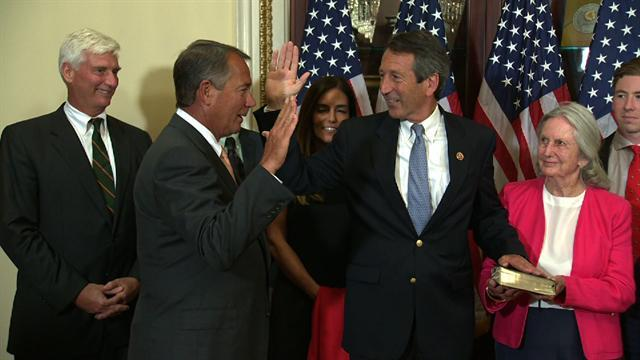 Sanford sworn into office with fiancee by his side