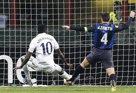 Tottenham Hotspur's Emmanuel Adebayor shoots to score past Inter Milan's Javier Zanetti during their Europa League soccer match in Milan