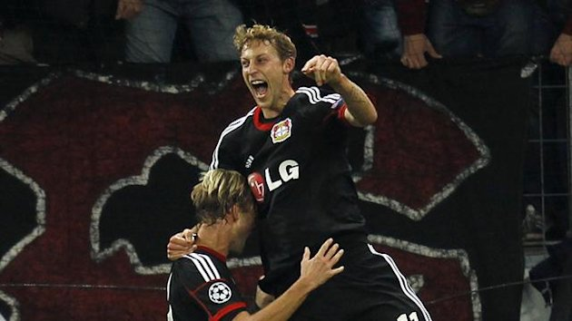 Bayer Leverkusen's Simon Rolfes and Stefan Kiessling (R) celebrate a goal against Real Sociedad during their Champions League Group A soccer match at BayArena in Leverkusen October 2, 2013 (Reuters)