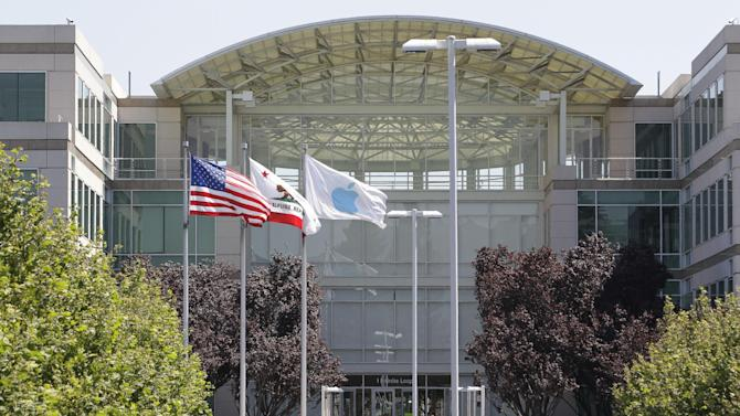 People walk into Apple headquarters in Cupertino, Calif., Monday, Aug. 20, 2012.  On Monday, Apple set a new record for the most valuable company at $621 billion, beating Microsoft's 1999 high. (AP Photo/Paul Sakuma)