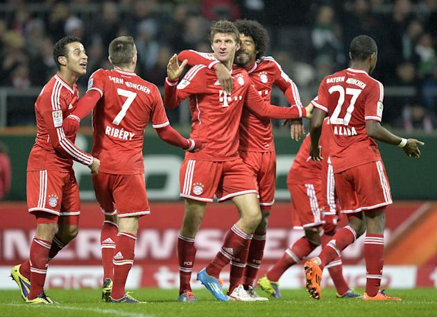 Bayern's Thomas Mueller, center, celebrates after scoringl during the German Bundesliga soccer match between WerderBremen and Bayern Munich in Bremen, Germany, Saturday, Dec. 7, 2013