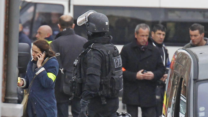 A RAID special intervention police officer arrives near the building where the suspected killer is hold-up  in Toulouse Wednesday March 21, 2012 .  After a pre-dawn raid erupted into a firefight, French riot police pressed Wednesday for the surrender of a holed-up gunman who is suspected in seven killings and claiming allegiance to al-Qaida. A prosecutor said the gunman was planning to kill another soldier imminently. (AP Photo/Remy de la Mauviniere)