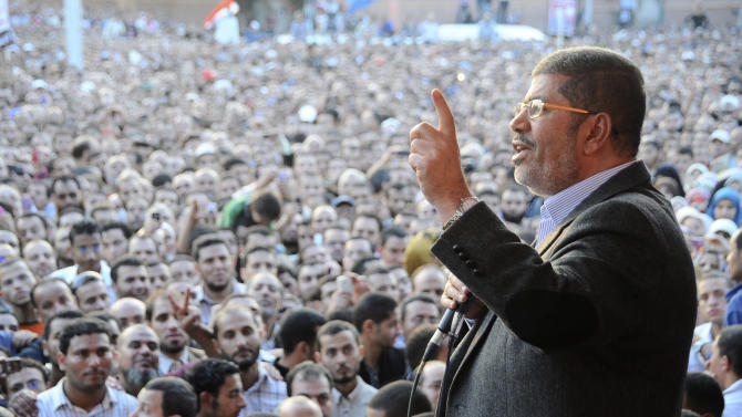 """In this Friday, Nov. 23, 2012 photo released by the Egyptian Presidency, President Mohammed Morsi speaks to supporters outside the Presidential palace in Cairo, Egypt.  Egypt's official news agency says that the country's highest body of judges has called the president's recent decrees an """"unprecedented assault on the independence of the judiciary and its rulings."""" In a statement carried on MENA Saturday, the Supreme Judicial Council says they regret the declarations President Mohammed Morsi issued Thursday.(AP Photo/Egyptian Presidency)"""