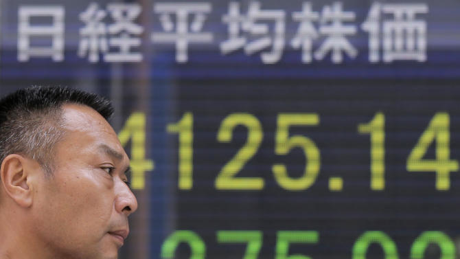 World stocks down, Fed official flags stimulus end