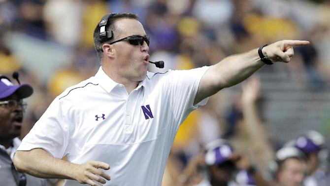 Northwestern head coach Pat Fitzgerald points as he yells to his team during the first half of an NCAA college football game against California in Evanston, Ill., Saturday, Aug. 30, 2014