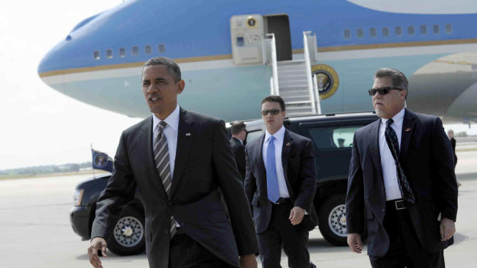 President Barack Obama heads over to greet people after arriving at Eastern Iowa Airport in Cedar Rapids, Iowa, Tuesday, July 10, 2012. (AP Photo/Susan Walsh)