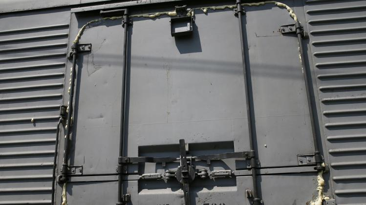 A wagon door of a train carrying the remains of victims of a Malaysian plane downed over rebel-held territory in eastern Ukraine is pictured after it arrived in the city of Kharkiv
