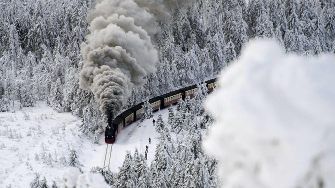 A train on a narrow-gauge railway line,  makes its way through the winter landscape near Wernigerode, northern Germany, Saturday, Dec. 8, 2012. Parts of Europe were hit hard by heavy snow and freezing temperatures. (AP Photo/dapd, Jens Schlueter)