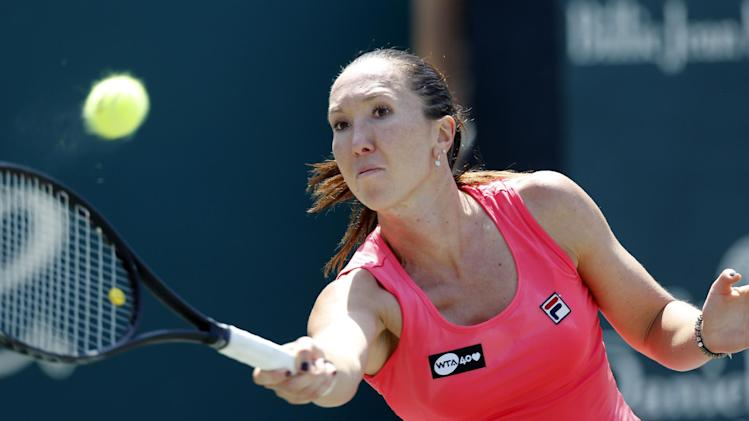Jelena Jankovic, of Serbia, returns to Serena Williams during the singles final at the Family Circle Cup tennis tournament in Charleston, S.C., Sunday, April 7, 2013.  Williams defeated Jankovic 3-6, 6-0, 6-2, to win the Family Circle Cup. (AP Photo/Mic Smith)