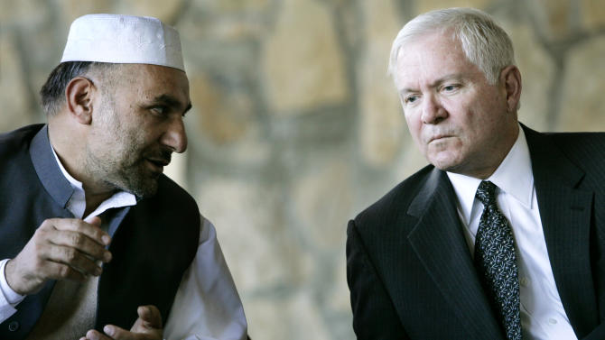FILE - In this Dec. 7, 2007 file photo, Defense Secretary Robert Gates, right, talks with Khowst Province Gov. Arsallah Jamal at the Tirazye District Center in Khowst Province, Afghanistan. Afghan officials say a bomb placed inside a mosque in the country's east has killed Jamal, now the governor of Logar province. They say the explosion took place as Jamal was delivering a speech on Tuesday morning, Oct. 15, 2013 to mark the Muslim holiday of Eid al-Adha. (AP Photo/Haraz N. Ghanbari, Pool, File)