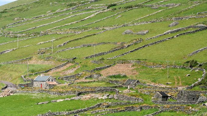 This May 29, 2012 photo shows stone walls on a hillside on the Dingle Peninsula, County Kerry, Ireland. Ireland is about 300 miles from north to south and a driving trip in the country's western region takes you along hilly, narrow roads with spectacular views ranging from seaside cliffs to verdant farmland. (AP Photo/Jake Coyle)