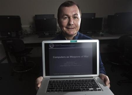 John Bumgarner, a cyber warfare expert who is chief technology officer of the U.S. Cyber Consequences Unit, a non-profit group that studies the impact of cyber threats, poses for a portrait in Charlotte, North Carolina December 1, 2011. REUTERS/John Adkisson