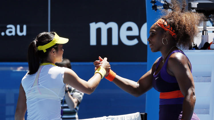 Serena Williams of the US, right, is congratulated by Japan's Ayumi Morita after Williams won their third round match at the Australian Open tennis championship in Melbourne, Australia, Saturday, Jan. 19, 2013. (AP Photo/Andy Wong)