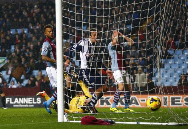 Aston Villa players react as West Bromwich Albion score a goal during their English Premier League soccer match at Villa Park in Birmingham