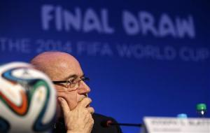 Blatter listens to a question during a news conference in Sao Joao da Mata