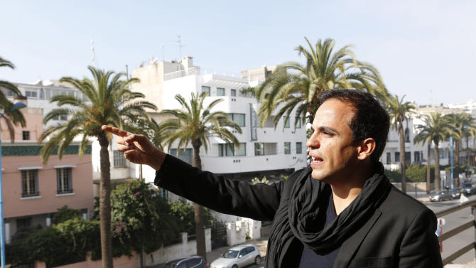 "Kamal Hachkar, director of the documentary ""Tinghir to Jerusalem""   gestures from a balcony in Casablanca , Friday, Feb, 15, 2013. Once home to some 300,000 Jews, the largest population in the Arab world, Morocco is increasingly taking a fresh look at its long history with Judaism. (AP Photo/Abdeljalil Bounhar)"