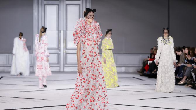 Models present creations by Italian designer Giambattista Valli as part of his Haute Couture Spring Summer 2015 fashion show in Paris