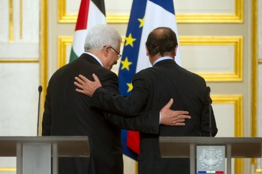 <p>French President Francois Hollande (R) and Palestinian leader Mahmud Abbas leave a press conference following a meeting at the Elysee presidential palace in Paris on June 8. Abbas said Saturday he is ready for a dialogue with Israel if it frees Palestinian prisoners taken before the 1993 Oslo peace accord</p>