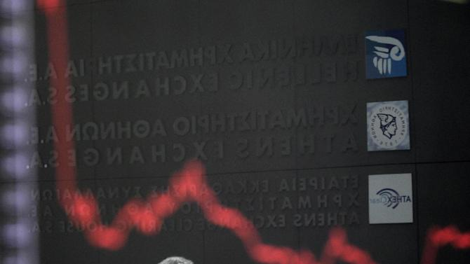 A man is reflected in the chart with stock prices at the Greek Stock Exchange in Athens, Monday, May 14, 2012. Greek party leaders are to resume power-sharing talks Monday as negotiations to create a government drag into a second week, raising the specter of fresh elections that could threaten the crisis-stricken country's international bailout and its membership of the euro. (AP Photo/Petros Giannakouris)