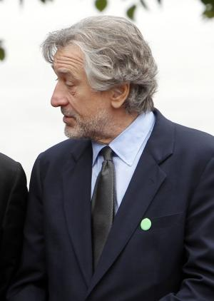 """FILE - In this Sept. 22, 2011 file photo, actor Robert De Niro is seen in New York. De Niro opened a fundraiser starring Michelle Obama by listing her Republican rivals and jokingly suggesting that America isn't """"ready for a white first lady."""" Newt Gingrich was not amused. And the Obama campaign says the actor's quip was inappropriate. (AP Photo/Jason DeCrow, File)"""