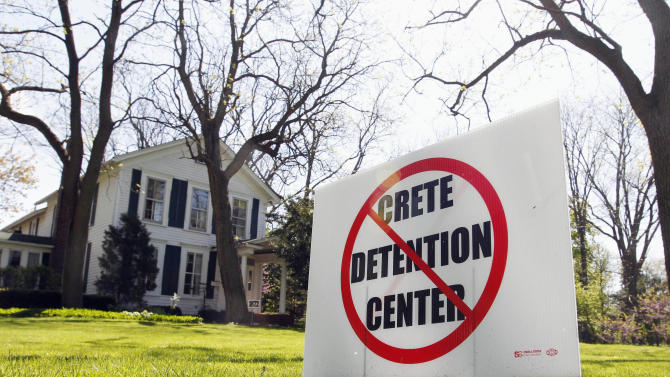 FILE -  In this April 11, 2012 file photo, an anti-detention sign is seen outside a home in Crete, Ill. Officials in Crete voted unanimously Monday, June 11, 2012, to reject a plan to build an immigrant detention center in the village. Plans for the detention center had led to protests by Crete residents and immigrant rights activists. (AP Photo/M. Spencer Green, File)