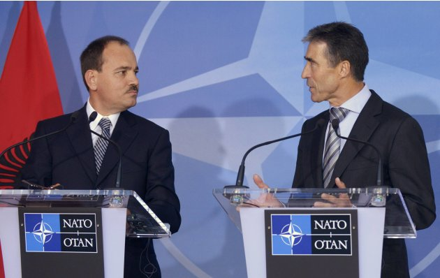NATO Secretary General Anders Fogh Rasmussen speaks as Albania's President Bujar Nishani (L) looks on, during a news conference after their meeting at the Alliance's headquarters in Brussels September 18, 2012.