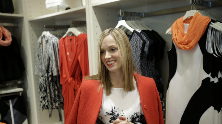 In this Wednesday, Jan. 23, 2013 photo, creative director for Ann Taylor, Lisa Axelson discusses fashion at Ann Taylor's renovated location in The Westchester shopping mall in White Plains, N.Y. She pointed out the styles that she believes are the cornerstone of a woman's wardrobe in 2013.  (AP Photo/Seth Wenig)