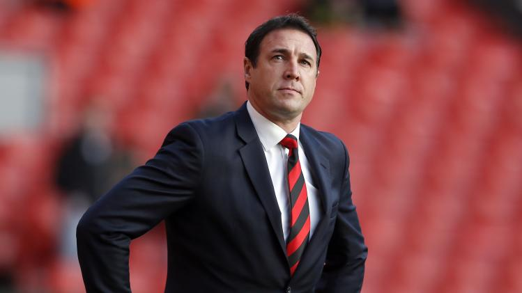 Cardiff City's manager Mackay walks onto the pitch before their English Premier League soccer match against Liverpool at Anfield in Liverpool