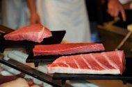 <p>Sushi restaurant chain Sushi-Zanmai displays blocks cut from a 269kg bluefin tuna to serve customers at a restaurant near Tokyo's Tsukiji fish market on January 5, 2012. The total allowable catch of Atlantic bluefin tuna today is 12,900 tonnes per year.</p>
