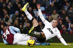 Aston Villa's Lowton challenges Manchester United's Rooney during their English Premier League soccer match in Birmingham