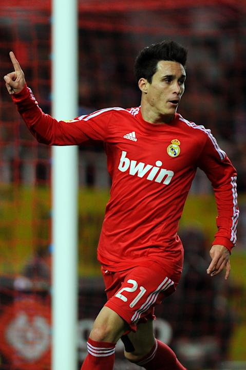 Real Madrid's midfielder Jose Maria Callejon celebrates after scoring during their Spanish league football match Sevilla FC vs Real Madrid on December 17, 2011 at Ramon Sanchez Pizjuan stadium in Sevi