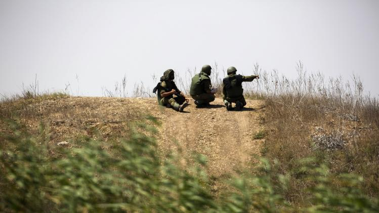 Israeli soldiers patrol near the border with Gaza
