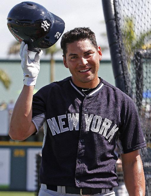 New York Yankees' Jacoby Ellsbury waits their turn in the batting cage before a spring training exhibition baseball game against the Pittsburgh Pirates in Bradenton, Fla., Thursday, March 5, 2015.  (AP Photo/Gene J. Puskar)