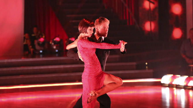 """This May 13, 2013 photo released by ABC shows country singer Kellie Pickler and her partner Derek Hough performing on the celebrity dance competition series """"Dancing with the Stars,"""" in Los Angeles. Pickler is one of four celebrities competing in the finals Monday, May 20.  A winner will be announced on Tuesday. (AP Photo/ABC, Adam Taylor)"""