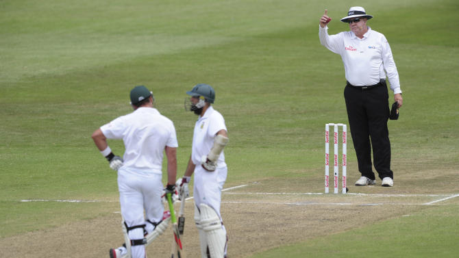 Umpire Steve Davis reverses a 'not out' decision and gives Jaques Kallis of South Africa out during a second five-day test match between South Africa and Sri Lanka in Durban, South Africa, Thursday, Dec. 29, 2011. (AP Photo)