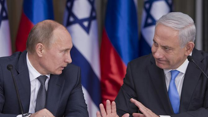 Russian President Vladimir Putin, left, listens to his host Israeli Prime Minister Benjamin Netanyahu as they prepare to deliver joint statements after their meeting and a lunch in the Israeli leader's Jerusalem residence, Monday, June 25, 2012. The West's standoff with Iran over its nuclear program was expected to top the agenda on Monday as Russian President Vladimir Putin began a 24-hour visit to Israel. (AP Photo/Jim Hollander, Pool)