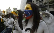 "Students hold a demonstration in front of government offices in Caracas on March 4, 2013 demanding the government reveal more about the health of cancer-stricken President Hugo Chavez. Information Minister Ernesto Villegas said Monday Chavez was suffering from a ""new and severe"" infection that has worsened his breathing"