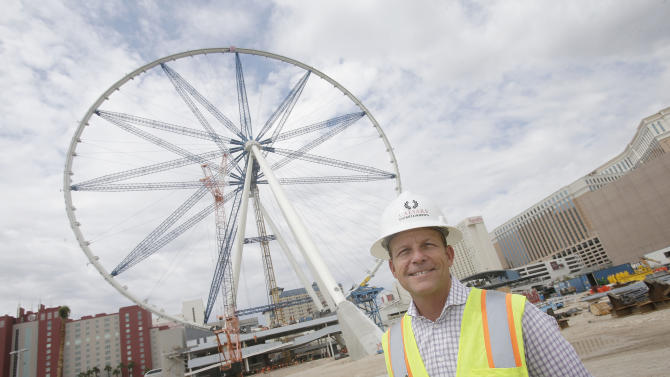 Linq Executive Project Director David Codiga is pictured in front of the 55-story High Roller Ferris wheel under construction near the Las Vegas Strip on Tuesday, Sept. 10, 2013, in Las Vegas. Caesars Entertainment Corp. is building the ride expected to open early next year. (AP Photo/Isaac Brekken)