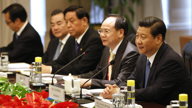 China's Xi offers to reduce friction over hotspots