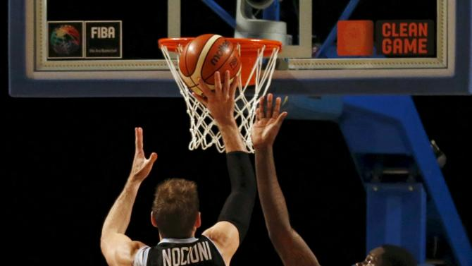 Argentina's Nocioni goes for the basket against Canada's Bennett during their 2015 FIBA Americas Championship basketball game