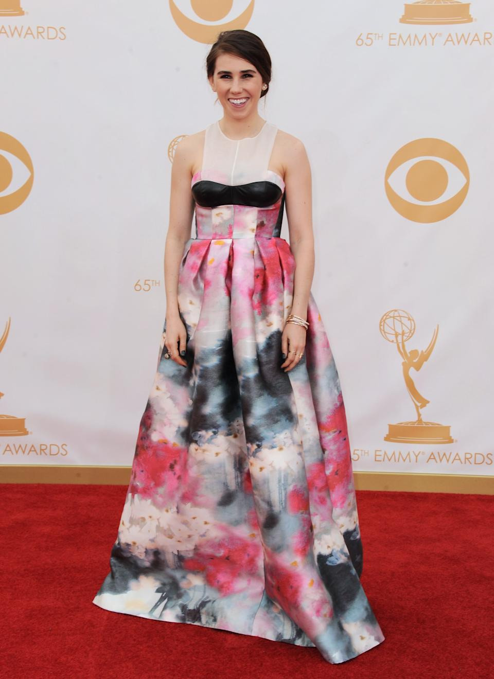 Zosia Mamet, wearing Honor, arrives at the 65th Primetime Emmy Awards at Nokia Theatre on Sunday, Sept. 22, 2013, in Los Angeles. (Photo by Jordan Strauss/Invision/AP)