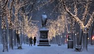 "A couple walks down the illuminated, snow-covered Commonwealth Avenue Mall in Boston, Friday, Feb. 8, 2013. Mass. Gov. Deval Patrick declared a state of emergency Friday and banned travel on roads as of 4 p.m. as a blizzard that could bring nearly 3 feet of snow to the region began to intensify. As the storm gains strength, it will bring ""extremely dangerous conditions"" with bands of snow dropping up to 2 to 3 inches per hour at the height of the blizzard, Patrick said. (AP Photo/Charles Krupa)"