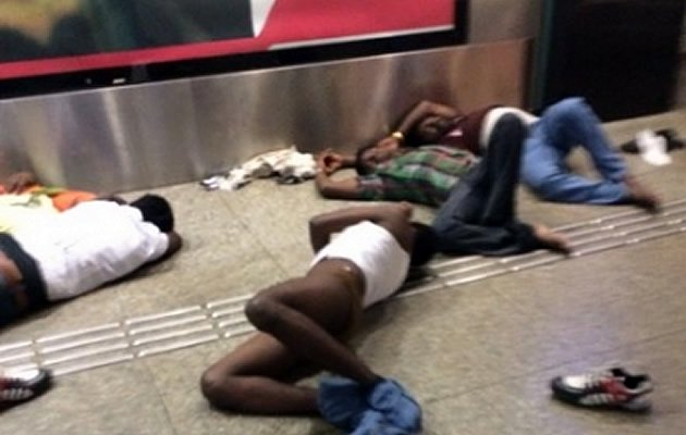 "A photo showing allegedly ""naked and drunk foreign workers"" at Bugis MRT station has gained buzz after it was shared on local blog The Real Singapore on Thursday. (Photo by Tamila Boyz/The Real Singapore)"