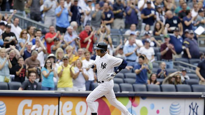 New York Yankees' Derek Jeter runs the bases after hitting a solo home run against the Tampa Bay Rays in a baseball game on Sunday, July 28, 2013, in New York. (AP Photo/Kathy Willens)