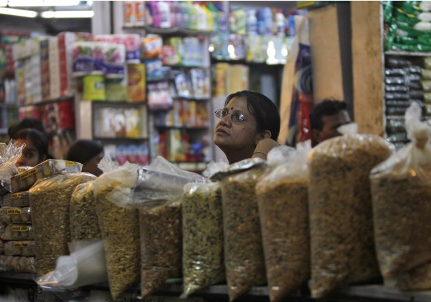 A customer shops at a family-owned store at a market in New Delhi